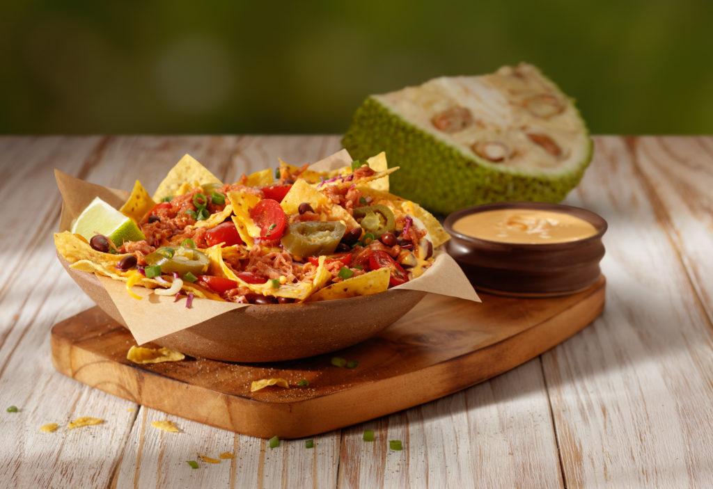 Outback - Jack Nachos_crocantes tortillas de milho servidas com feijões pretos_tomate_repolho roxo_carne vegetariana